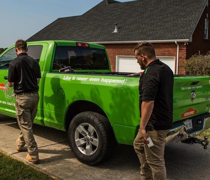 SERVPRO technicians next to truck