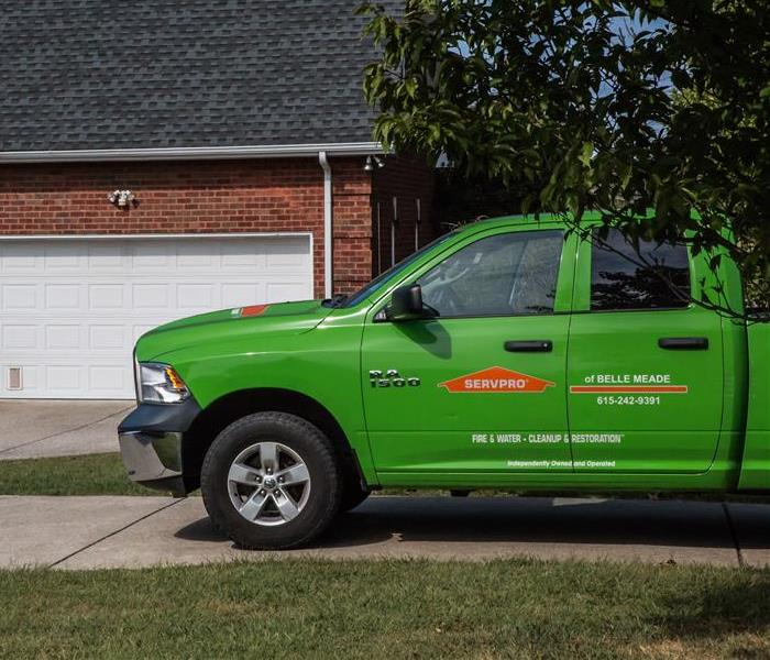 SERVPRO truck next to house
