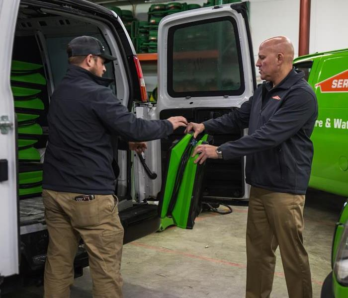 SERVPRO technicians loading up van