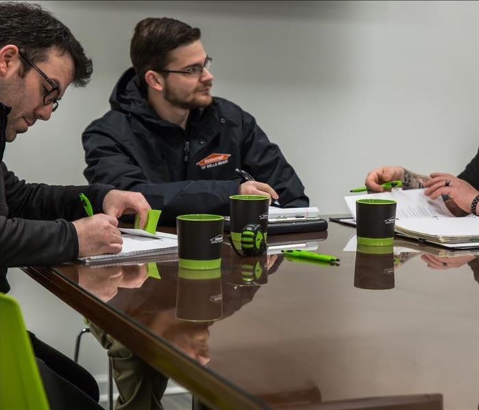 SERVPRO technicians around table