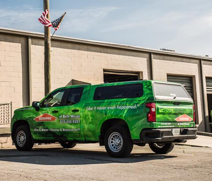 SERVPRO truck next to commercial building