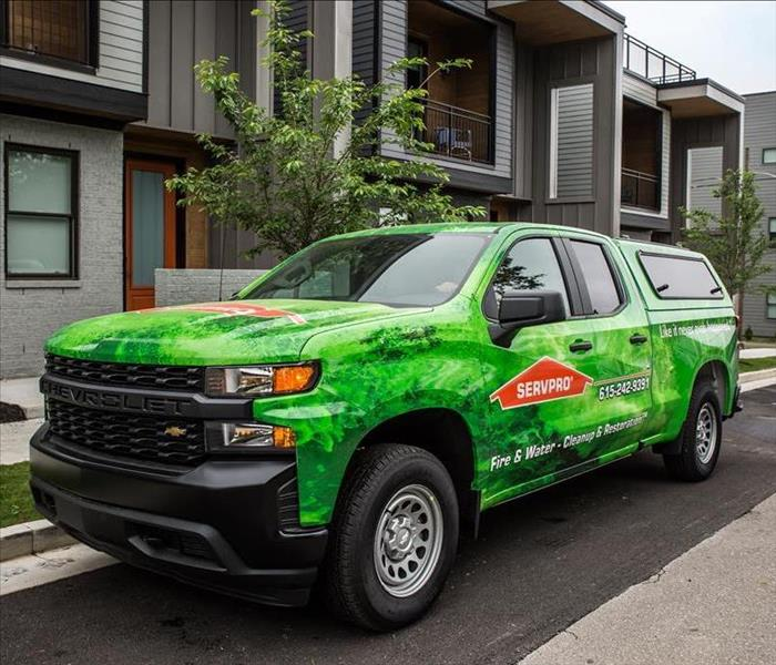 SERVPRO truck outside townhomes