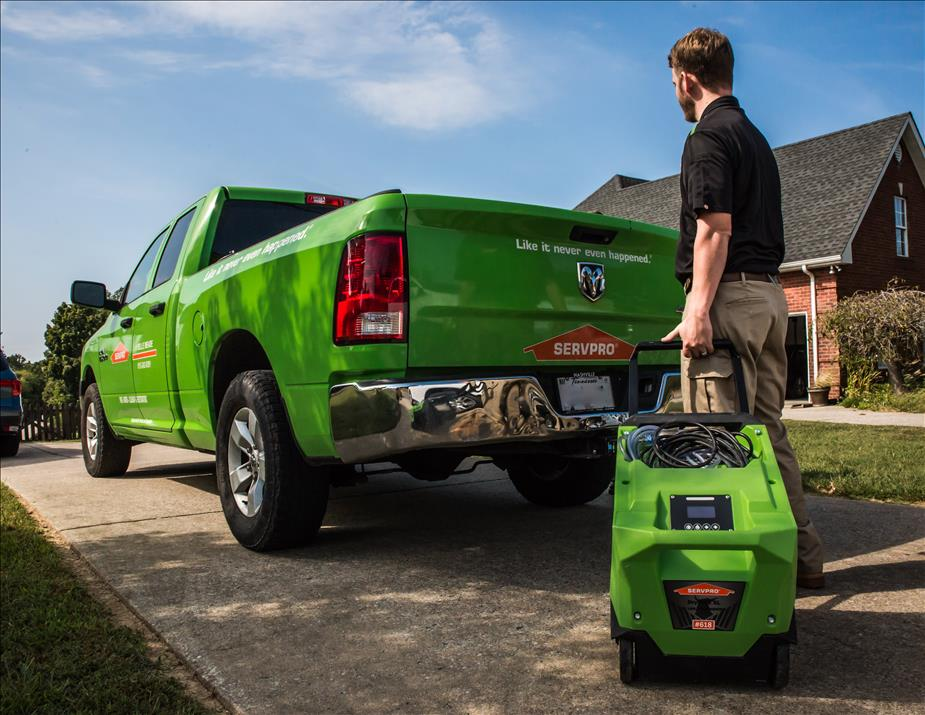 SERVPRO technician and truck